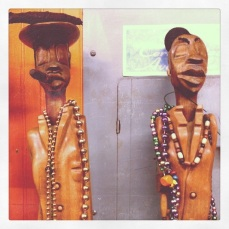 Statuettes in a French Quarter cigar shop