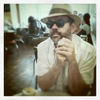 Hal in his new NoLa hat, in Cafe Du Monde