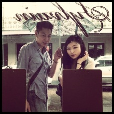 Good-looking couple examines Sylvain menu; rainy afternoon