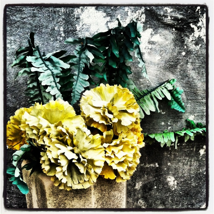 Yellow faux carnations