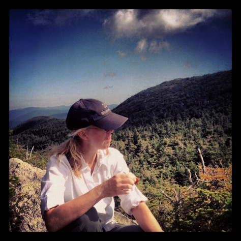 Kim eats an apple atop Mt. Mansfield